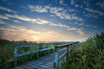 wooden bridge for bikes at sunrise