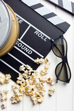 clapperboard with 3d glasses and popcorn