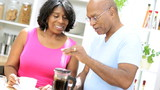 Mature African American Couple Preparing Fresh Coffee