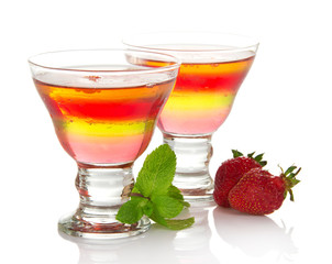 Glass with fruit jelly and strawberry