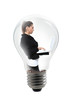 Young pretty business woman with notebook in a bulb lamp