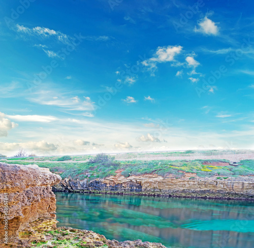 rocky shore with clouds