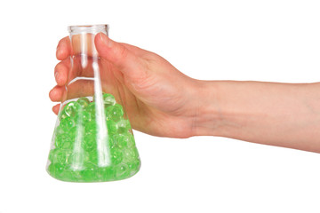 Flask with green substance in hand