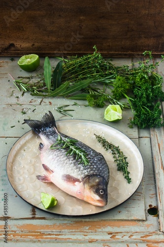 Fresh crucian with herbs and lime