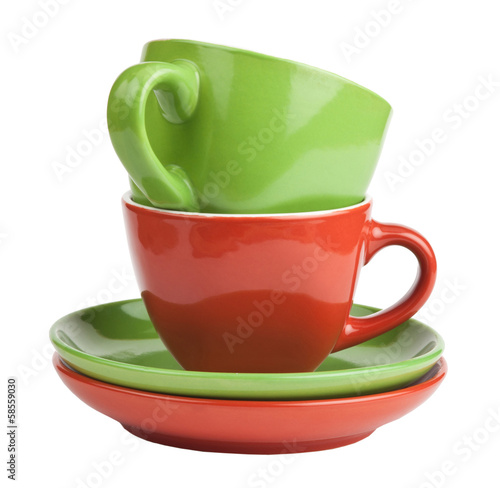 stack of red and green tea cups and saucers
