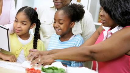 Three Generations Ethnic Family Kitchen Wireless Tablet