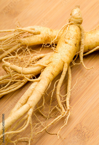Fresh Ginseng on the wooden background