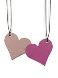 two heart shaped paper tags