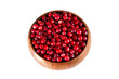 Ripe cranberry in wooden bowl