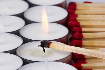 matches ignited white candles