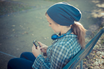 beautiful young blonde hipster woman on the phone