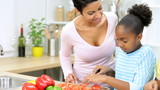 African American Mother Daughter Preparing Food Kitchen