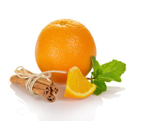 Bright ripe orange, sticks of cinnamon and mint
