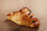 Butter and chocolate croissant on wooden table