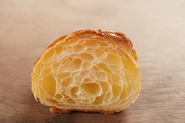 Butter croissant interior close-up on wooden table