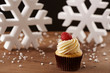 Raspberry cupcake on Christmas background