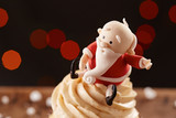 Santa Claus cupcake detail on Christmas background