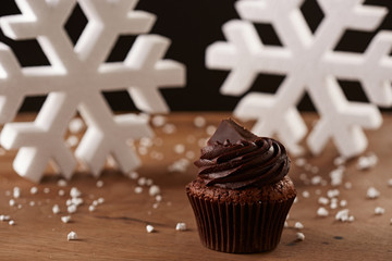 Black chocolate cupcake on Christmas background