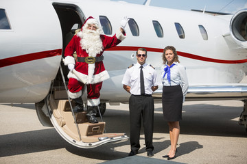 Santa Waving Hand On Private Jet