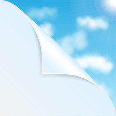 eco background.white clouds against a blue sky.bent corner of wh