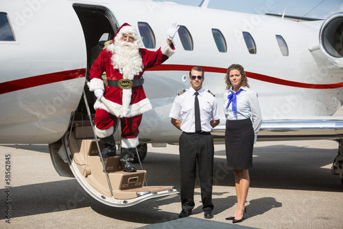 Santa Waving Hand On Private Jet