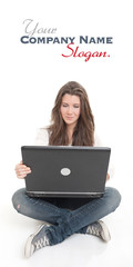 Cheerful young brunette using laptop