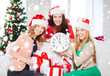 women in santa helper hats with clock showing 12