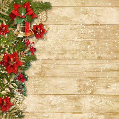 Christmas beautiful garland with poinsettia&bell on a wooden boa
