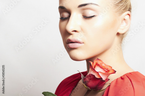 Girl and flower. beautiful woman in red dress.close-up. rose