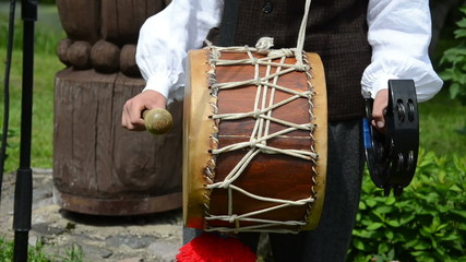 Drummer play folk country music with drum and bells