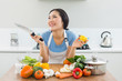Thoughtful woman chopping vegetables in kitchen