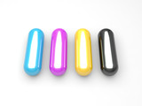 Four colored capsules in CMYK