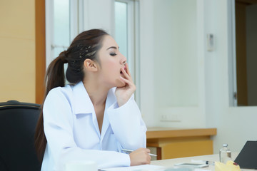 Female doctor had a very exhausting day at work