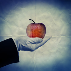 holding apple paper backdrop