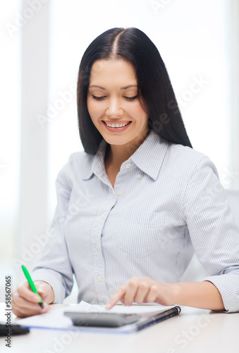 businesswoman or student working with calculator