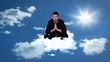 Calm meditating businessman sitting on cloud