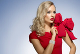 cute blond young girl in red with big bow