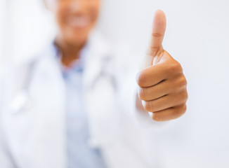 female doctor showing thumbs up