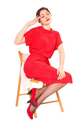 Girl in a red dress on white background