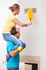 Man helping his wife in cleaning