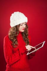 brunette girl  holding ipad touchs screen searing internet