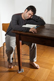 portrait of man sleeping on the wooden table