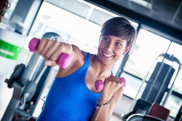 Happiness woman doing exercise with weights