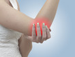 Pain in a woman elbow