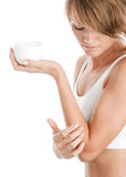 Woman applying body lotion on her elbow