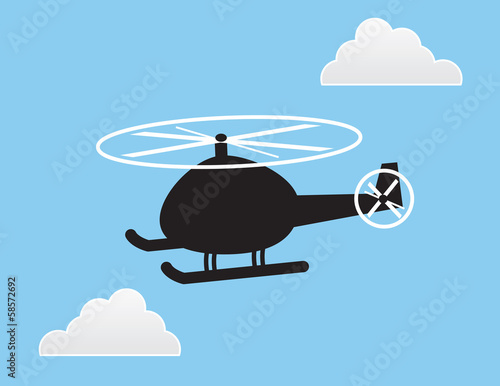 Helicopter silhouette in the sky with clouds