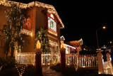 Fototapety Decorated house with christmas lights