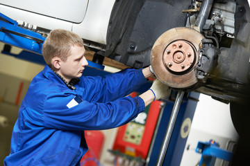 auto mechanic at car suspension repair work