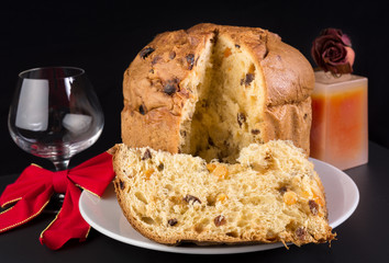 Delicious panettone, Christmas cake with glass of wine