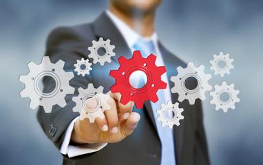 Businessman cogwheel concept